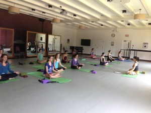 Head Counselor Mary Lachman leads a yoga workshop for the dancers on their day off.