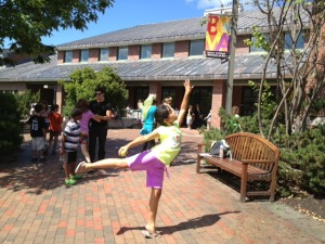 One YAP student shows off her arabesque between classes outside of the Olin Arts Center.